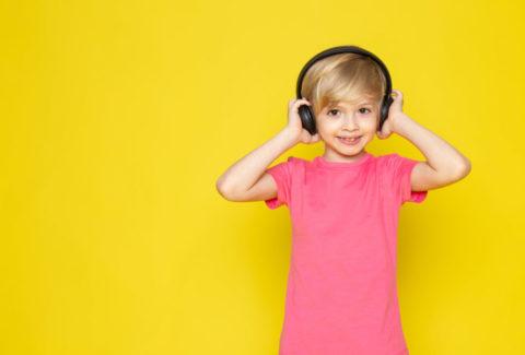 little-boy-pink-t-shirt-black-headphones-listening-music